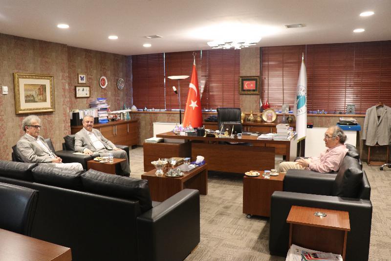Dr. Osman Coşkun, Prof. Dr. Nevzat Tarhan'ı makamında ziyaret etti